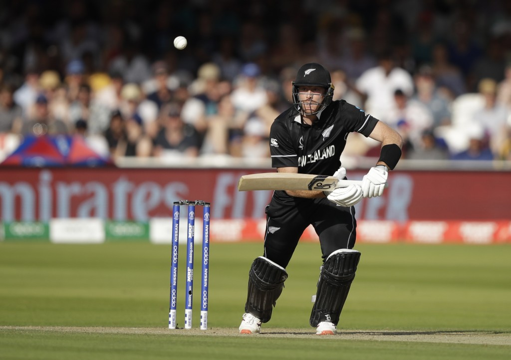 New Zealand's Martin Guptill hits runs off the bowling of Australia's Mitchell Starc during the Cricket World Cup match between New Zealand and Austra