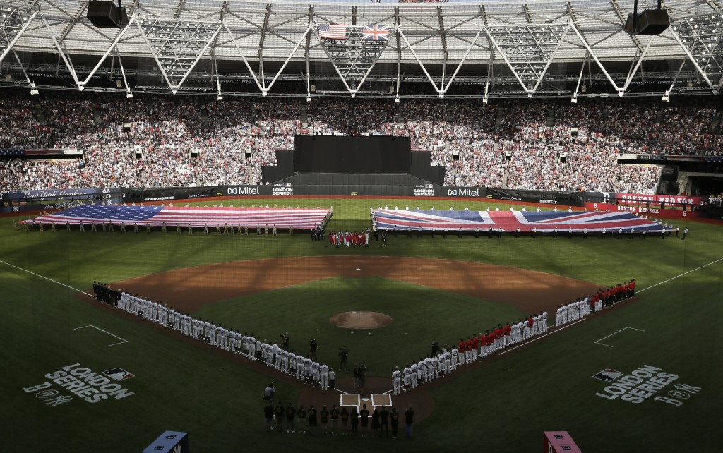 Boston Red Sox and New York Yankees players line up as flags are unfurled before a baseball game, Saturday, June 29, 2019, in London. Major League Bas...