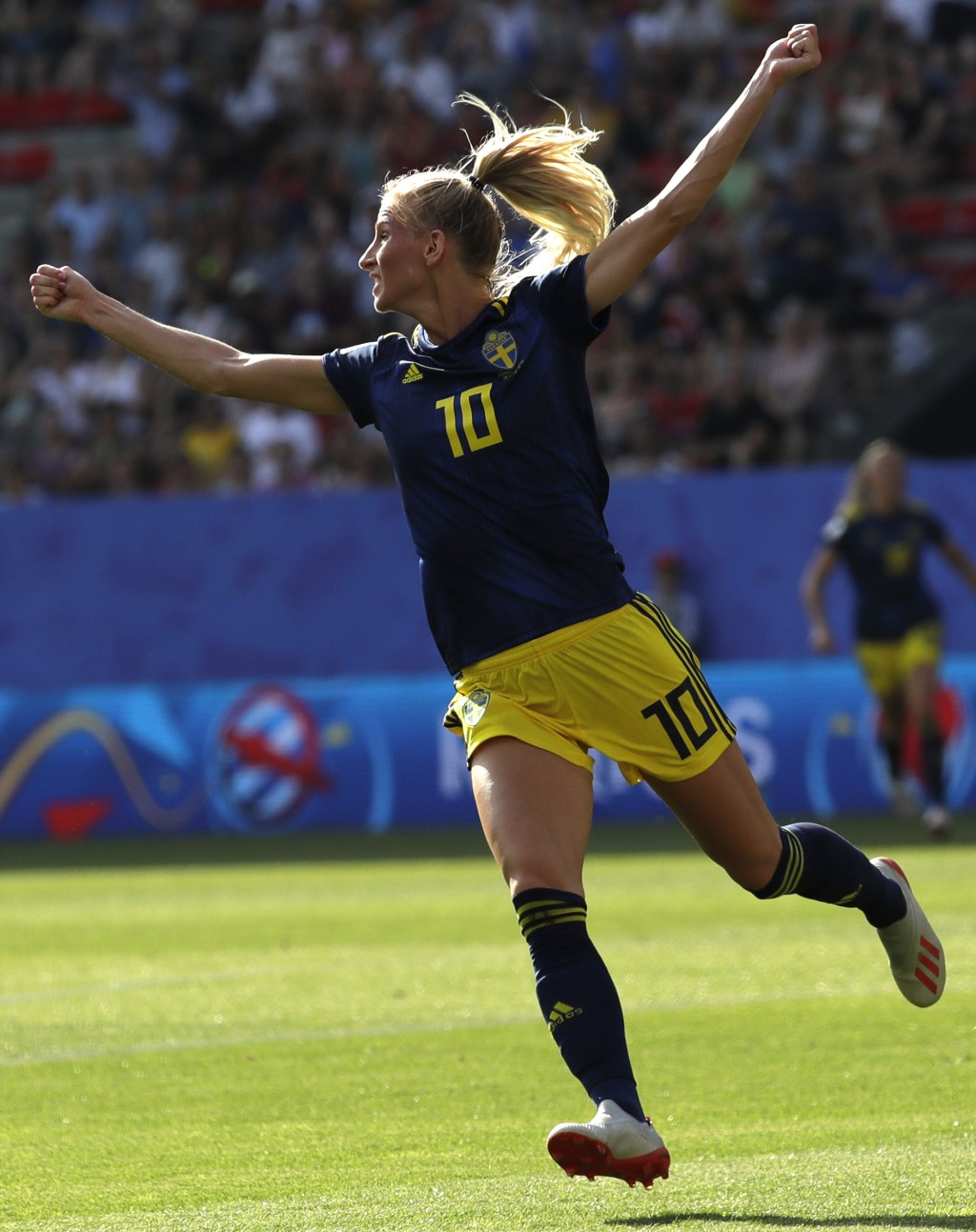 Sweden's Sofia Jakobsson celebrates after scoring her side's opening goal during the Women's World Cup quarterfinal soccer match between Germany and S...