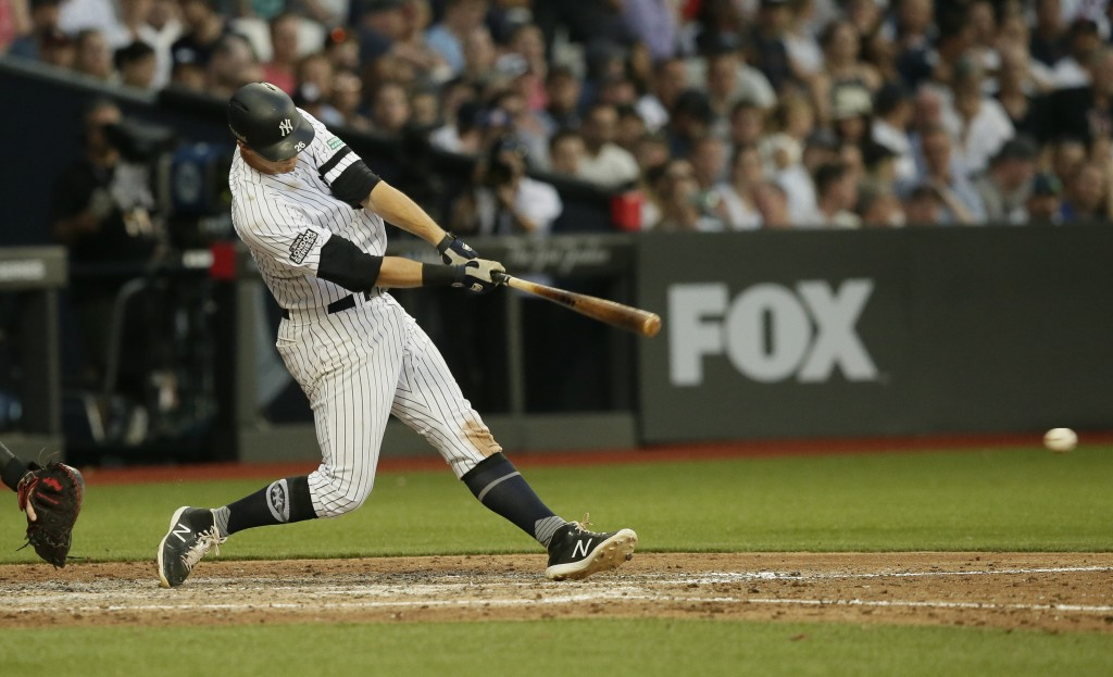 New York Yankees' DJ LeMahieu hits an RBI single against the Boston Red Sox during the fifth inning of a baseball game, Saturday, June 29, 2019, in Lo...