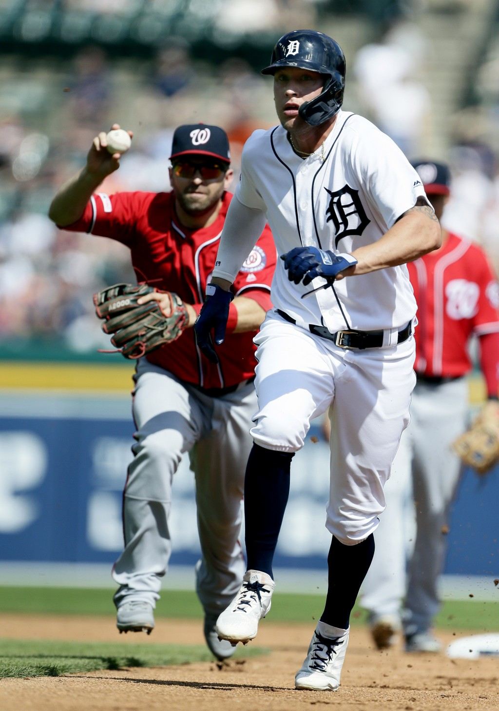 Detroit Tigers' JaCoby Jones, right, is pursued by Washington Nationals' Brian Dozier after getting caught in a rundown between first base and second ...