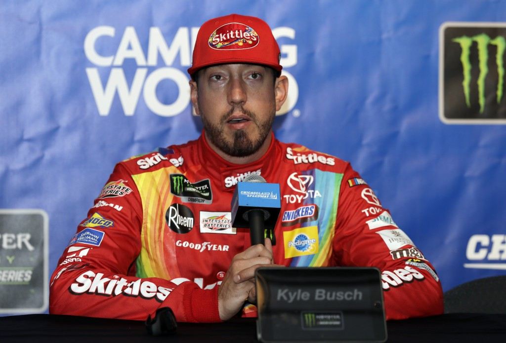 Kyle Busch talks to media during a practice for the NASCAR Sprint Cup Series auto race at Chicagoland Speedway in Joliet, Ill., Saturday, June 29, 201...