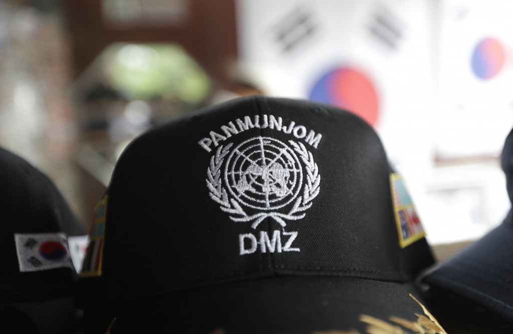 A cap showing letters of Panmunjom and Demilitarized Zone, is placed at a souvenir shop at the Imjingak Pavilion in Paju, South Korea, Sunday, June 30...