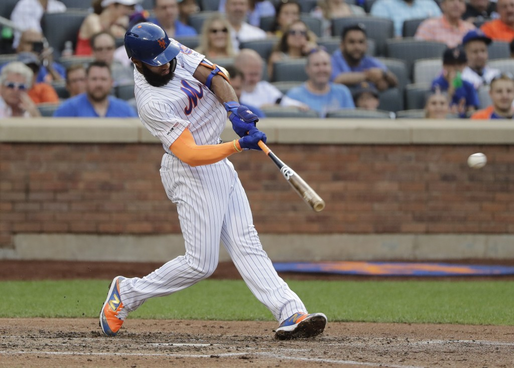 New York Mets' Amed Rosario hits a double during the fourth inning of the team's baseball game against the Atlanta Braves on Saturday, June 29, 2019, ...