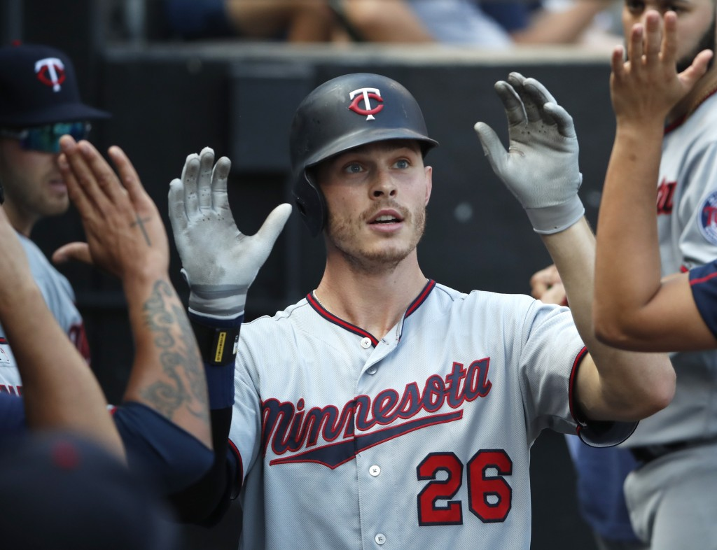 Minnesota Twins' Max Kepler (26) celebrates in the dugout after hitting his second home run of the day against the Chicago White Sox during the sevent...