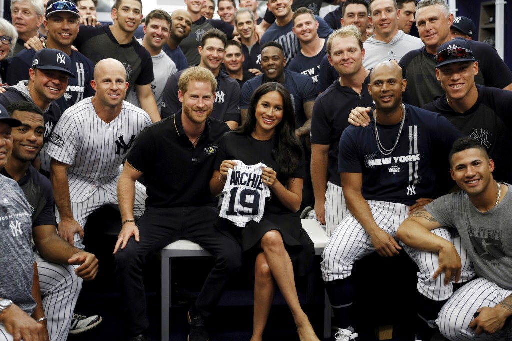 Britain's Prince Harry and Meghan, Duchess of Sussex meet players of the New York Yankees before a match against the Boston Red Sox  in London, Saturd...