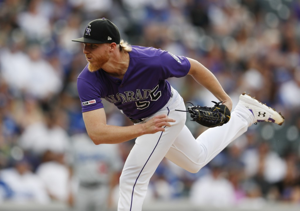 Colorado Rockies starting pitcher Jon Gray works against the Los Angeles Dodgers in the first inning of a baseball game Saturday, June 29, 2019, in De...