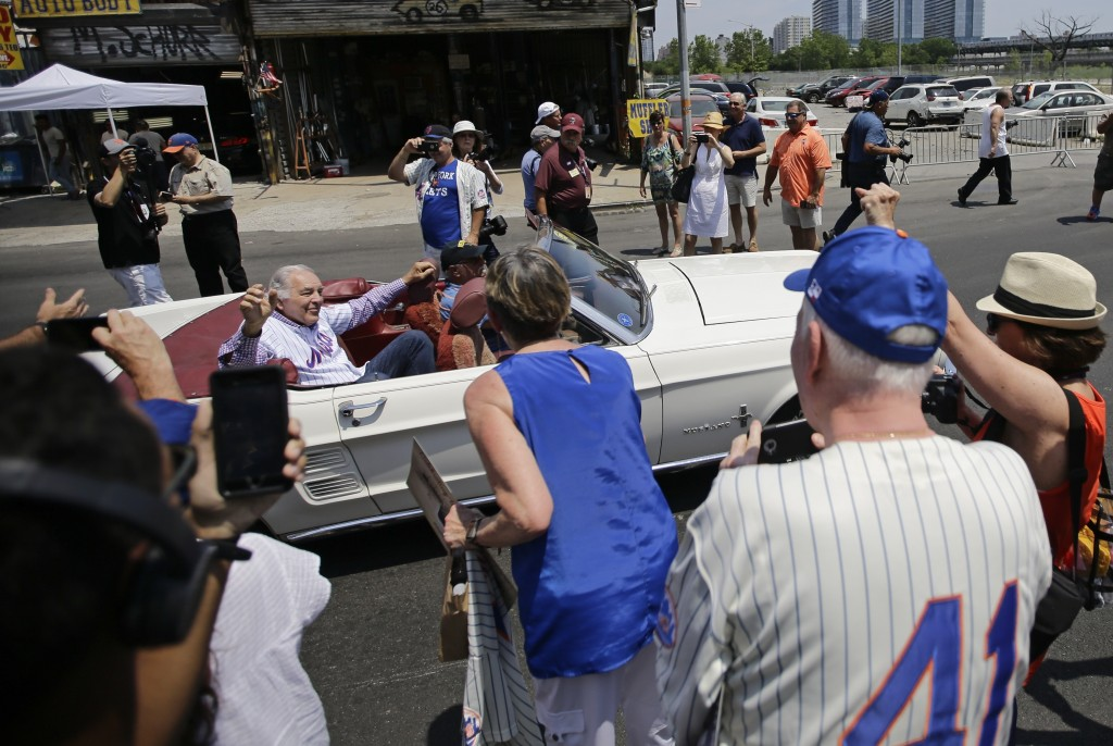 Former New York Mets player Ed Kranepool waves to fans during a parade to honor the 1969 New York Mets near Citi Field before a baseball game against ...