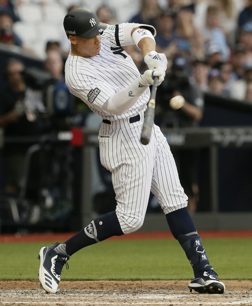 New York Yankees' Aaron Judge hits a two-run home run against the Boston Red Sox during the fourth inning of a baseball game, Saturday, June 29, 2019,...