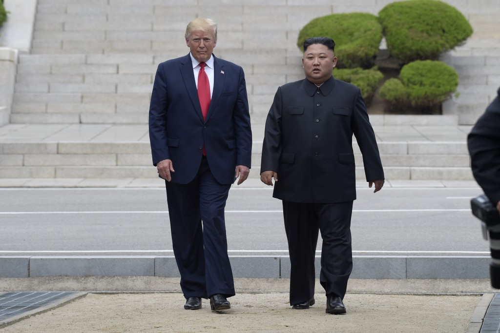 President Donald Trump and North Korean leader Kim Jong Un walk on the North Korean side in the Demilitarized Zone, Sunday, June 30, 2019 at Panmunjom...