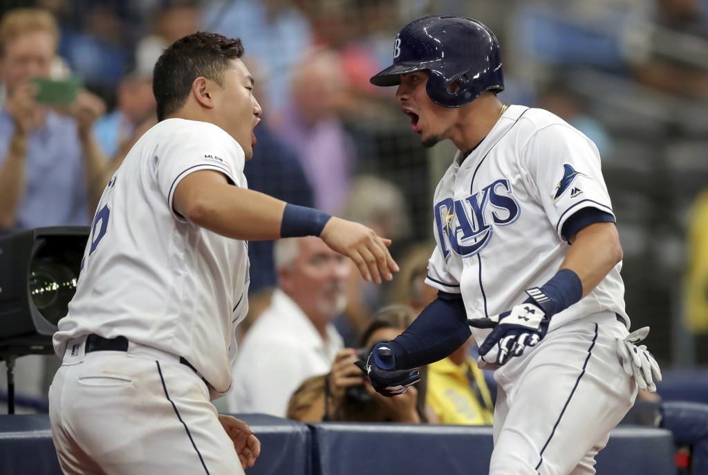 Tampa Bay Rays' Willy Adames, right, celebrates with Ji-Man Choi after his home run against the Texas Rangers during the seventh inning of a baseball ...