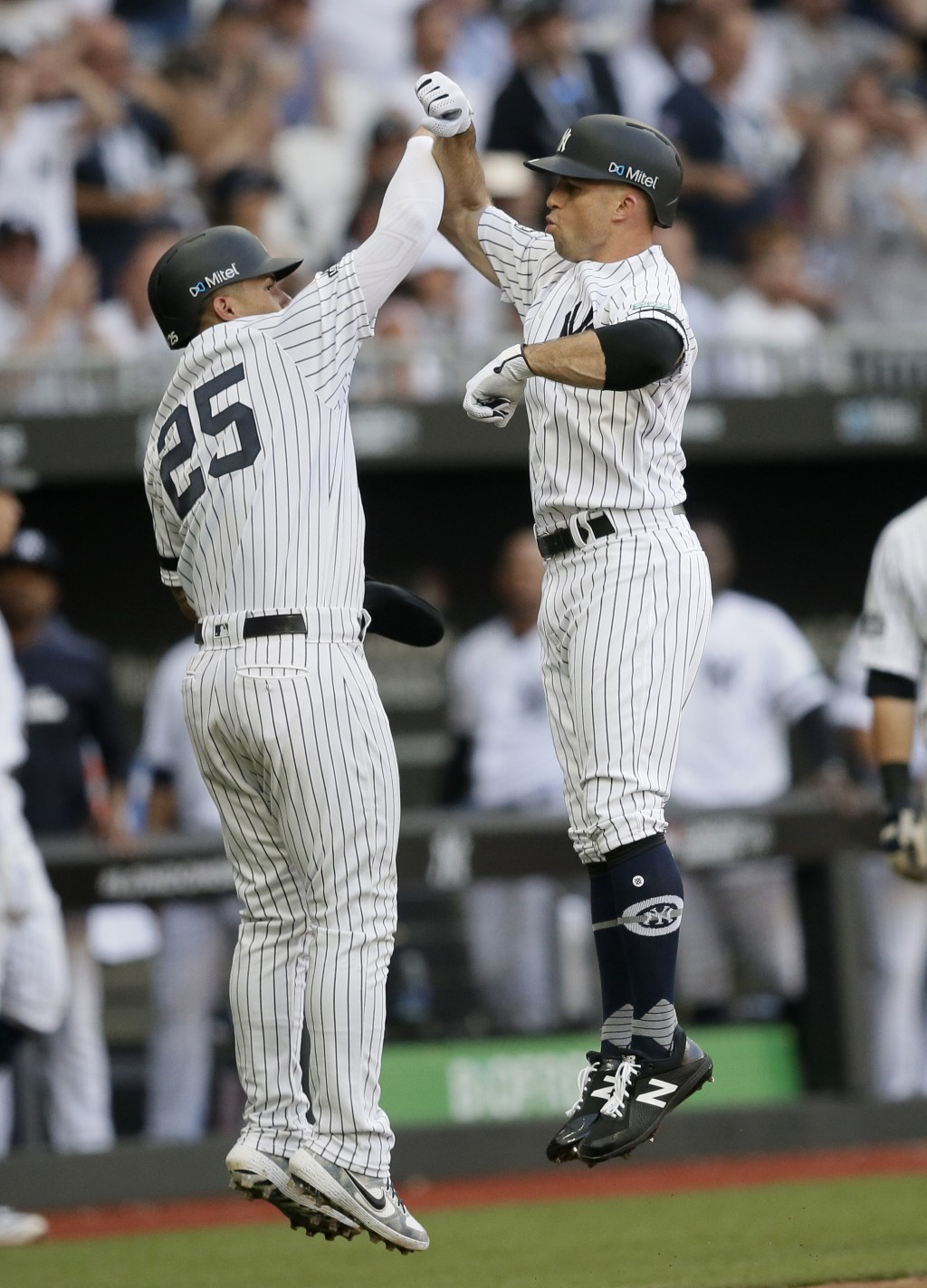 New York Yankees' Brett Gardner, right, celebrates after hitting a two-run home run with Gleyber Torres during the third inning of a baseball game aga...