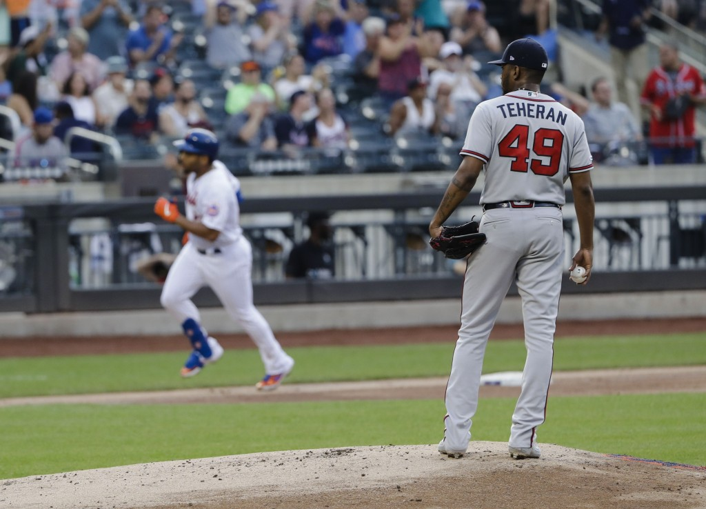 Atlanta Braves starting pitcher Julio Teheran (49) waits as New York Mets' Dominic Smith runs the bases after hitting a home run during the third inni...