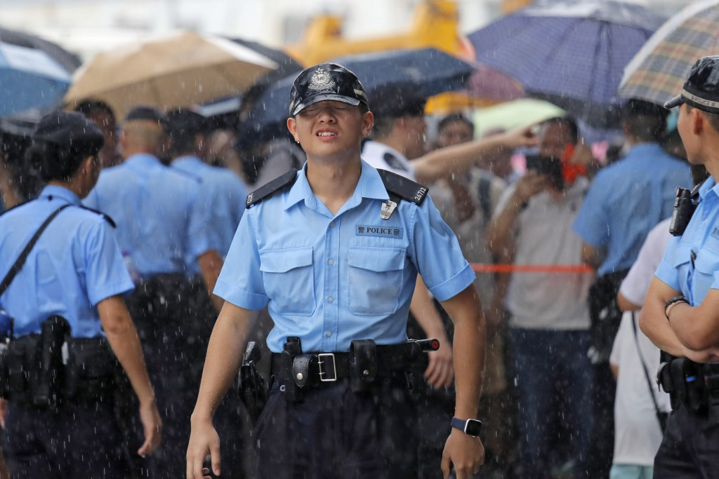 Police officers stand guard during a rally outside Legislative Council Complex in Hong Kong, Sunday, June 30, 2019. Pro-China's supporters rallied in ...