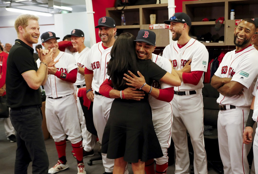 Britain's Prince Harry and Meghan, Duchess of Sussex meet Boston Red Sox players before a match against the New York Yankees in London, Saturday June ...