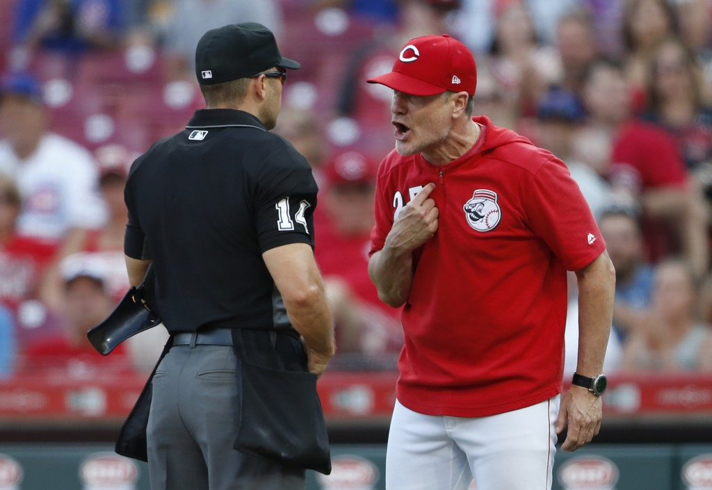 Cincinnati Reds manager David Bell (25) argues with home plate umpire Mark Wegner over whether Reds batter Jose Peraza was hit by a Chicago Cubs pitch...