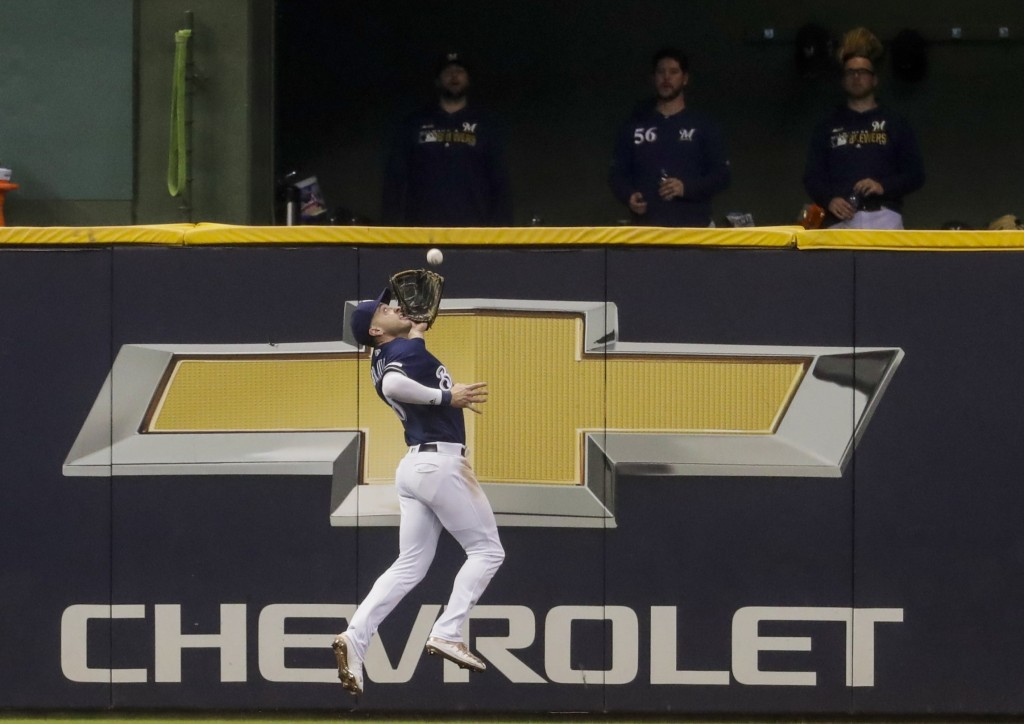 Milwaukee Brewers' Ryan Braun makes a running catch on a ball hit by Pittsburgh Pirates' Starling Marte during the fifth inning of a baseball game Sat...