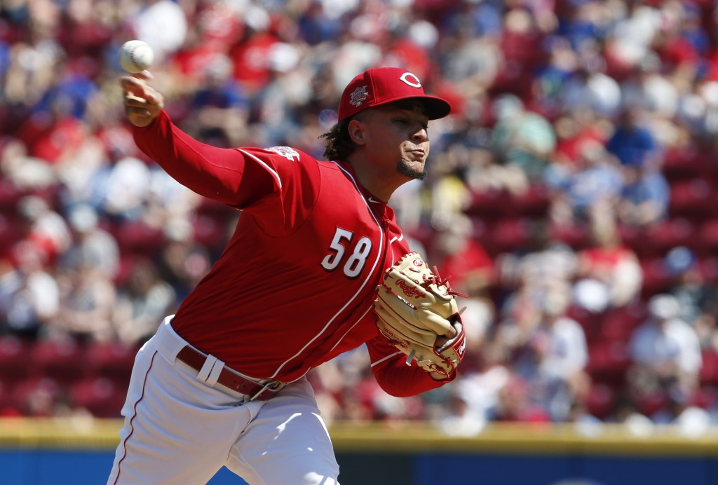 Cincinnati Reds starting pitcher Luis Castillo (58) throws against the Chicago Cubs during the first inning of a baseball game, Saturday, June 29, 201...