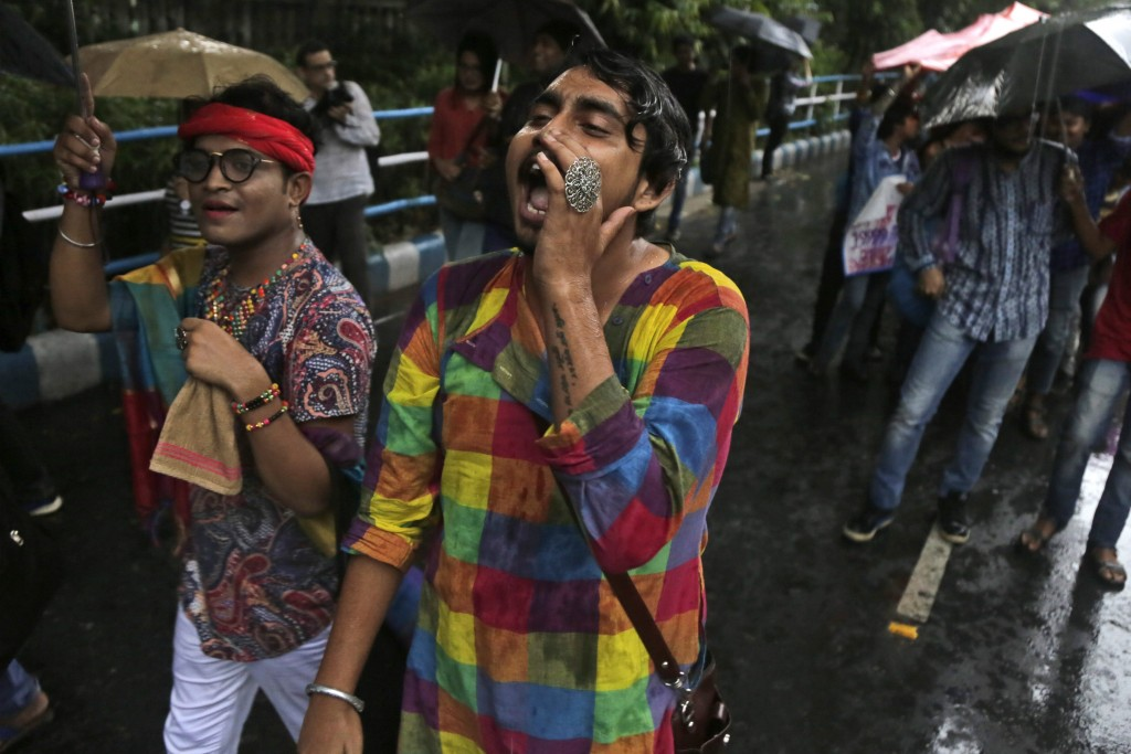 Gay rights activists walk in a rally to commemorate the twentieth anniversary of the first pride parade in the country, in Kolkata, India, Saturday, J...