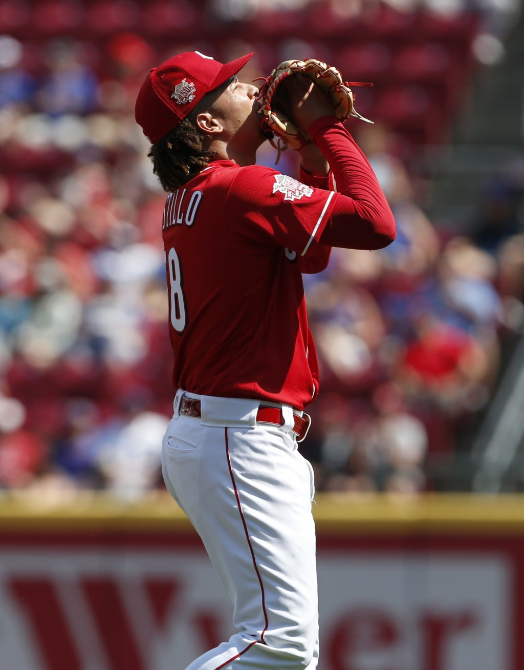 Cincinnati Reds starting pitcher Luis Castillo looks skyward after striking out the side during the first inning of a baseball game against the Chicag...