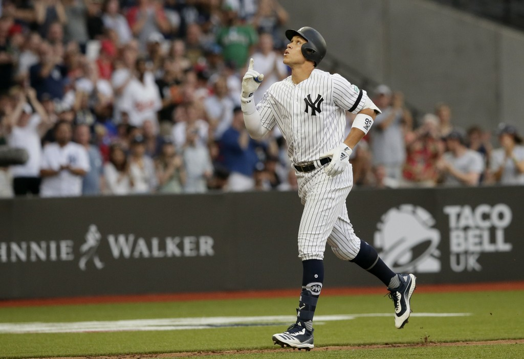 New York Yankees' Aaron Judge reacts as he rounds the bases after a two-run home run against the Boston Red Sox during the fourth inning of a baseball...