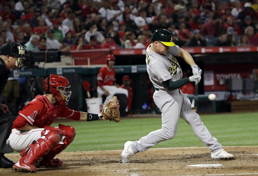 Oakland Athletics' Matt Chapman hits a two-run home run against the Los Angeles Angels during the fifth inning of a baseball game Saturday, June 29, 2...