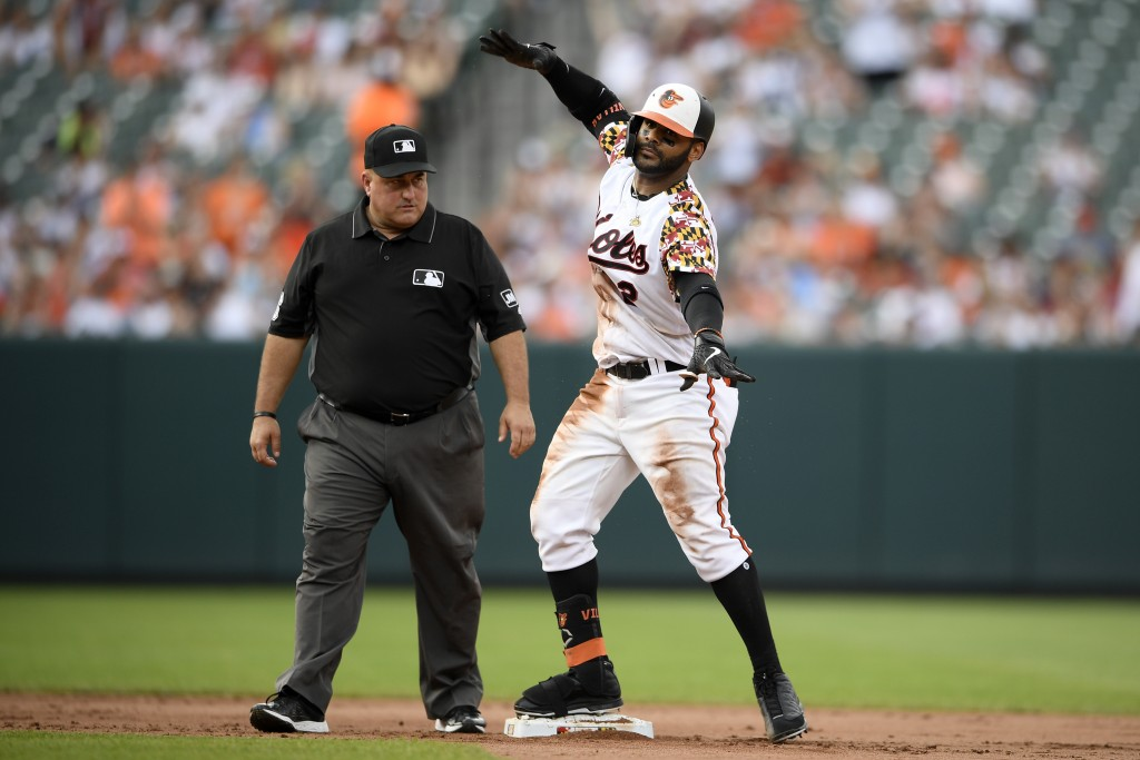 Baltimore Orioles' Jonathan Villar reacts after hitting a two-run double during the fourth inning of the team's baseball game against the Cleveland In...