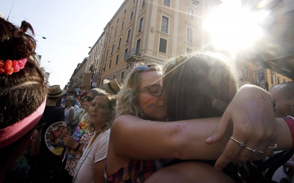 Revelers kiss during the gay pride parade in Milan, Italy, Saturday, June 29, 2019. (AP Photo/Luca Bruno)