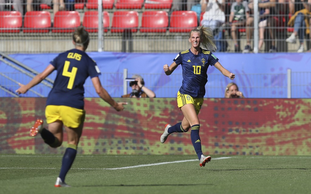 Sweden's Sofia Jakobsson, right, celebrates with teammate Hanna Glas after scoring her side's first goal during the of the Women's World Cup quarterfi...
