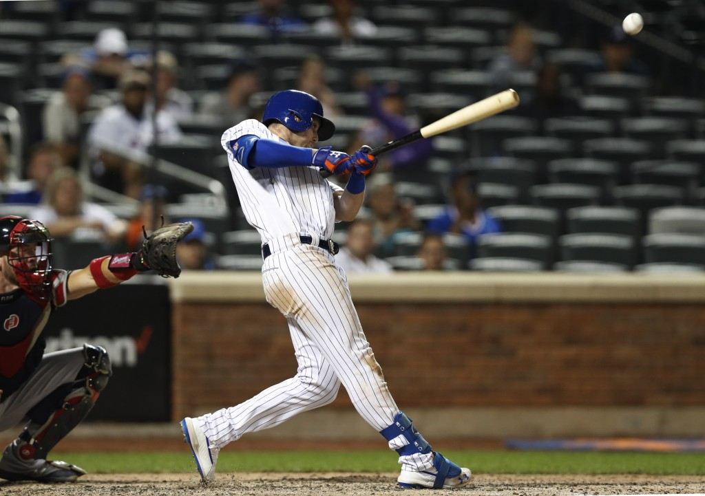 New York Mets' Jeff McNeil hits a go-ahead, two-run single during the eighth inning of a baseball game against the Atlanta Braves, Sunday, June 30, 20...
