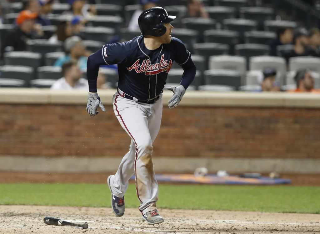 Atlanta Braves' Freddie Freeman watches his two-run double during the seventh inning of a baseball game against the New York Mets, Sunday, June 30, 20...