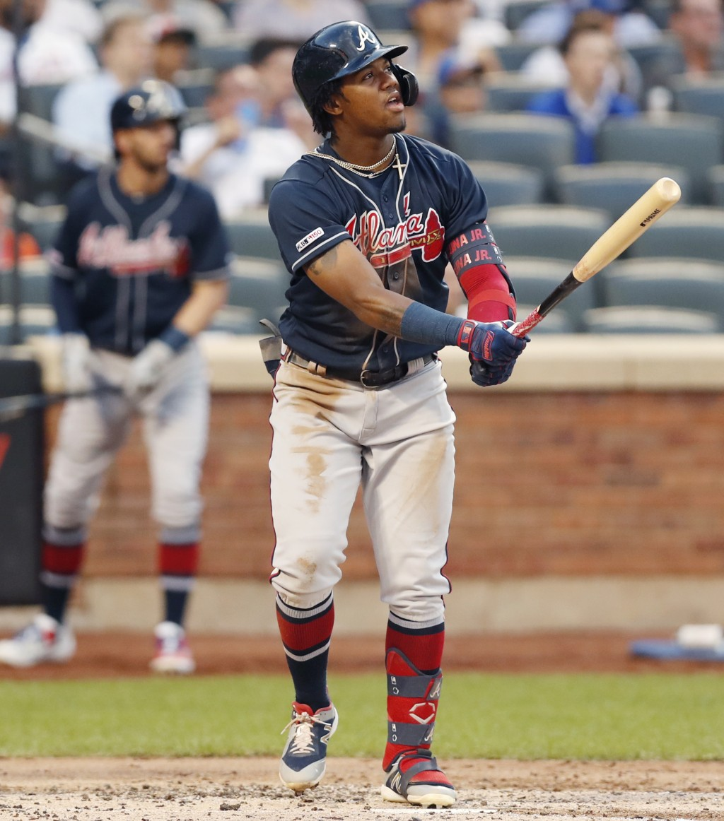 Atlanta Braves' Ronald Acuna Jr. (13) watches his solo home run during the third inning of a baseball game against the New York Mets, Sunday, June 30,...