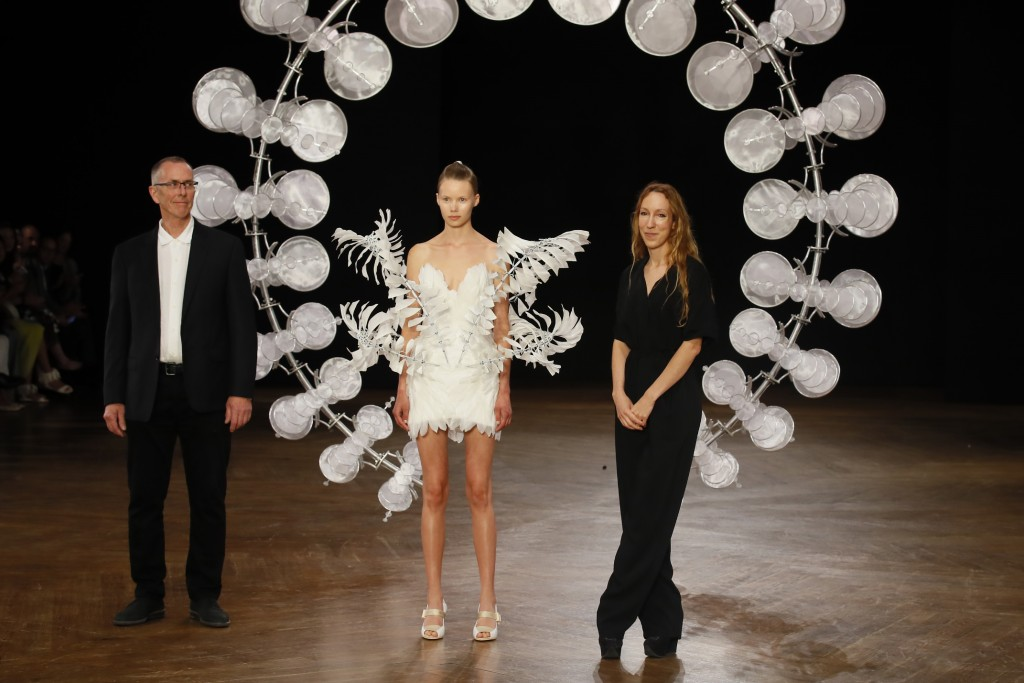 Dutch fashion designer Iris van Herpen, right, pauses after the presentation of her Haute Couture Fall-Winter 2019-2020 fashion collection in Paris, M...