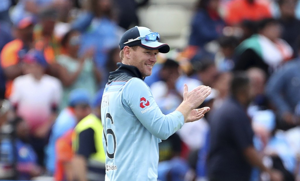 England's captain Eoin Morgan celebrates after their win over India in the Cricket World Cup match at Edgbaston in Birmingham, England, Sunday, June 3