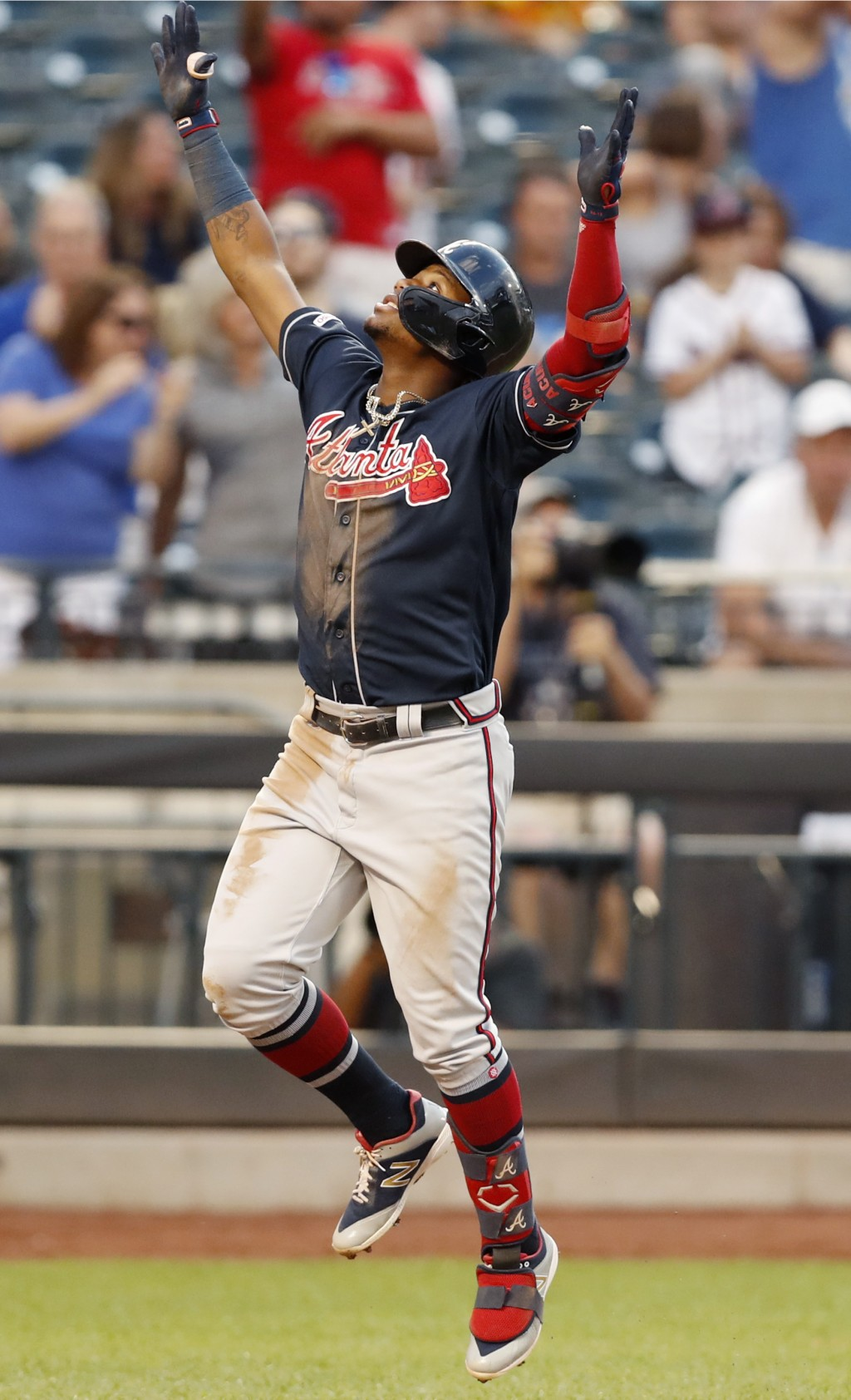 Atlanta Braves' Ronald Acuna Jr. reacts at the plate after hitting a solo home run during the third inning of a baseball game against the New York Met...