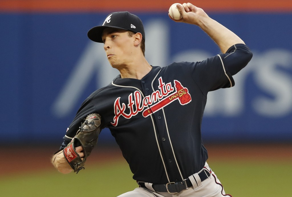 Atlanta Braves starting pitcher Max Fried winds up during the second inning of a baseball game against the New York Mets, Sunday, June 30, 2019, in Ne...