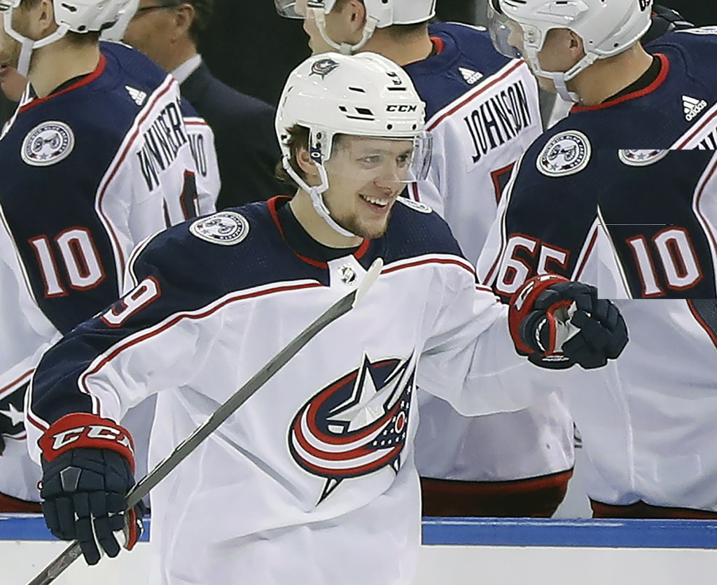 FILE - In this March 20, 2018, file photo, Columbus Blue Jackets left wing Artemi Panarin (9) is congratulated by teammates after scoring a goal again...