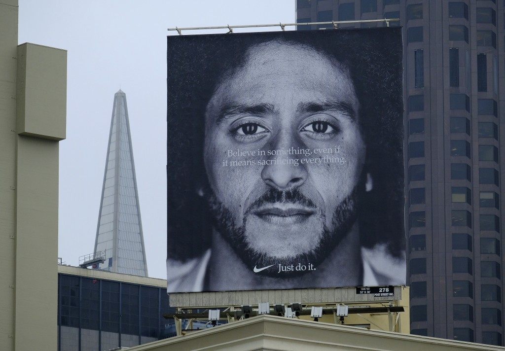 FILE - In this Sept. 5, 2018, file photo, a large billboard stands on top of a Nike store showing former San Francisco 49ers quarterback Colin Kaepern