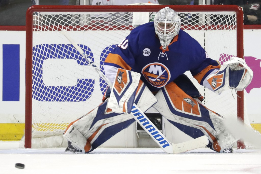 FILE - In this April 26, 2019 file photo New York Islanders goaltender Robin Lehner, of Sweden, defends his net against the Carolina Hurricanes during...