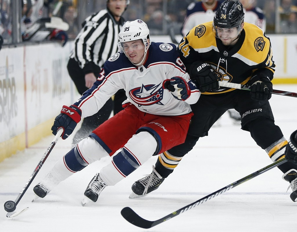 FILE - In this March 16, 2019, file photo, Columbus Blue Jackets' Matt Duchene, left, battles Boston Bruins' Jake DeBrusk (74) for the puck during the...
