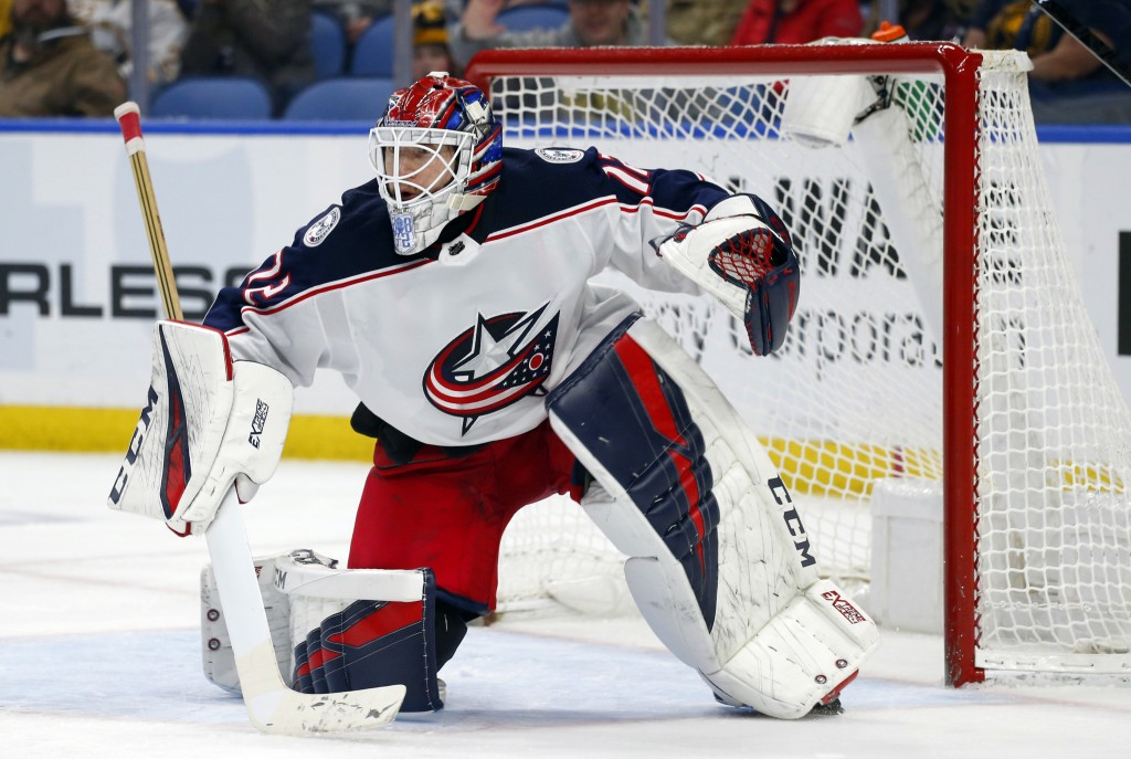 FILE - In this March 31, 2019, file photo, Columbus Blue Jackets goalie Sergei Bobrovsky looks on during the third period of an NHL hockey game agains...