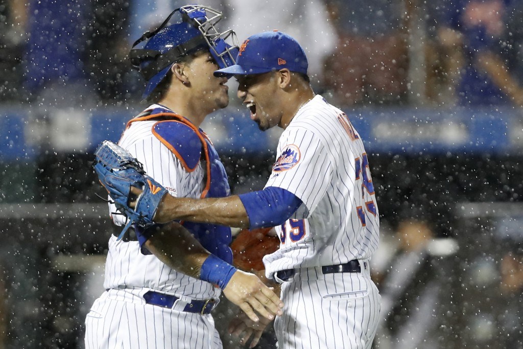 New York Mets' relief pitcher Edwin Diaz, right, celebrates with catcher Wilson Ramos after Diaz closed out the Mets 4-2 win over the New York Yankees...