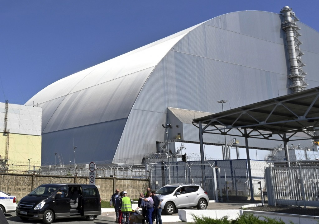 FILE - This June 1, 2019, file photo shows a view of the New Safe Confinement (NSC) movable enclosure at the nuclear power plant in Chernobyl, Ukraine...