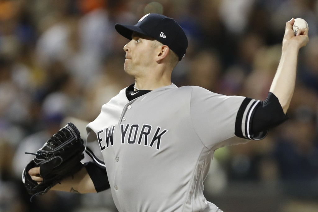 New York Yankees' starting pitcher James Paxton throws during the fifth inning of an interleague baseball game against the New York Mets, Tuesday, Jul...