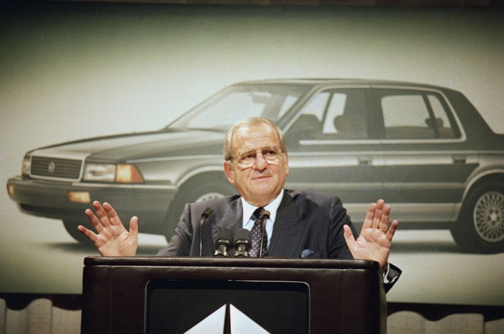 FILE - In this Feb. 2, 1989, file photo, Chrysler Corp. Chairman Lee Iacocca gestures while speaking about fourth quarter pre-tax earnings which are u