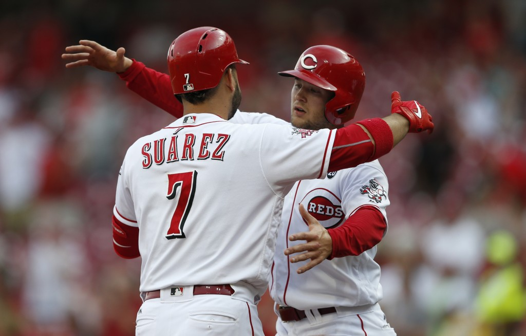 Puig scores winning run in 11th, Brewers lose 5-4 to Reds