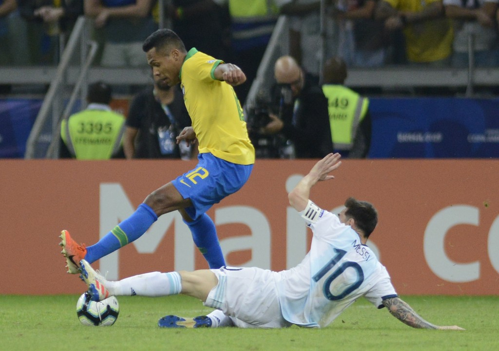 Brazil's Alex Sandro, left, fights for the ball with Argentina's Lionel Messi during a Copa America semifinal soccer match at Mineirao stadium in Belo...