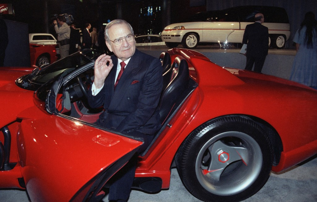 FILE - In this March 28, 1990, file photo, Chrysler Corporation Chairman Lee Iacocca sits in a 1990 Dodge Viper sports car as the Chrysler in the 90's