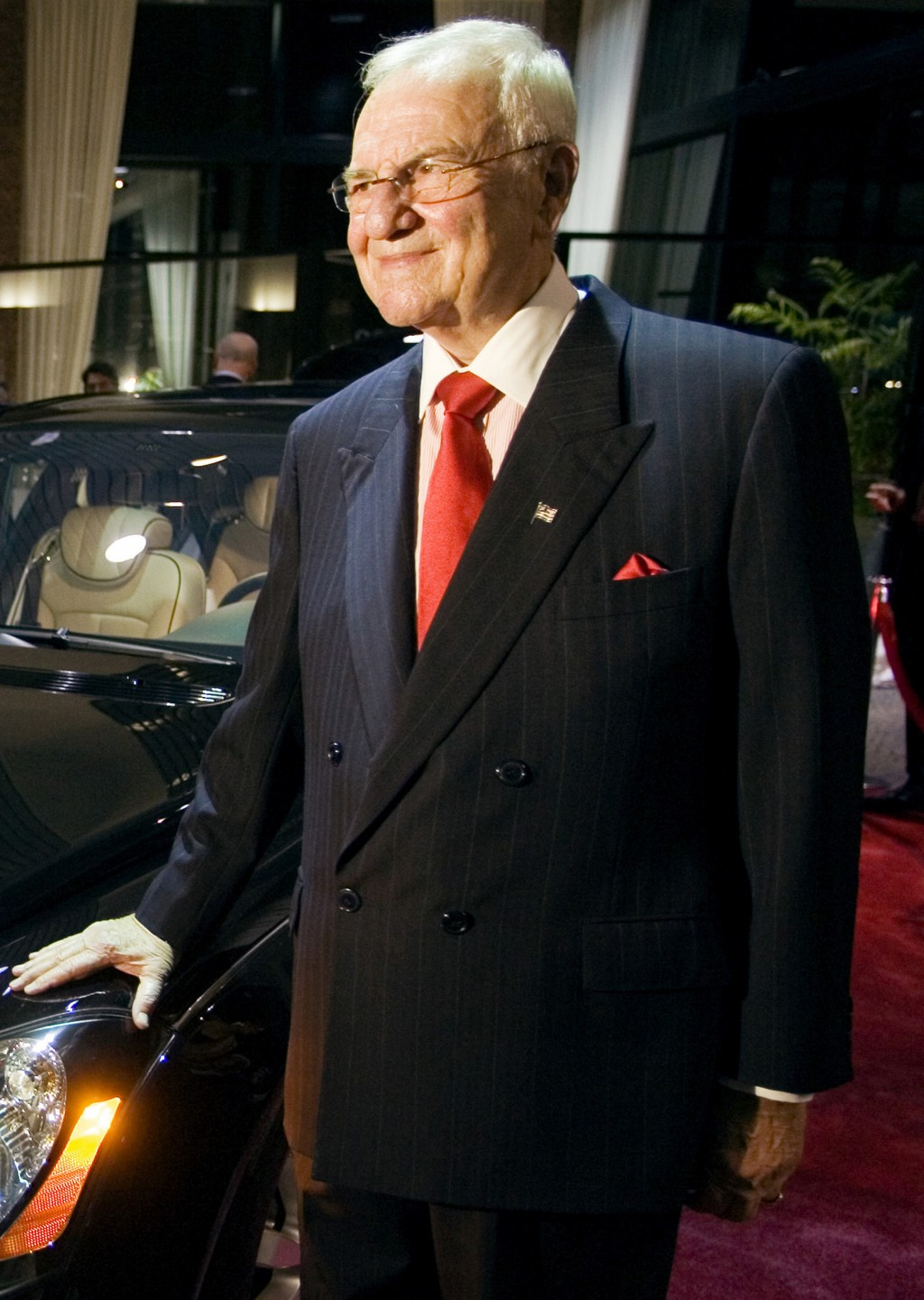 FILE - In this Oct. 18, 2005, file photo, Lee Iaccoca poses with the new custom made Maybach 57 S, as the car is unveiled at the Mercedes-Benz of Beve