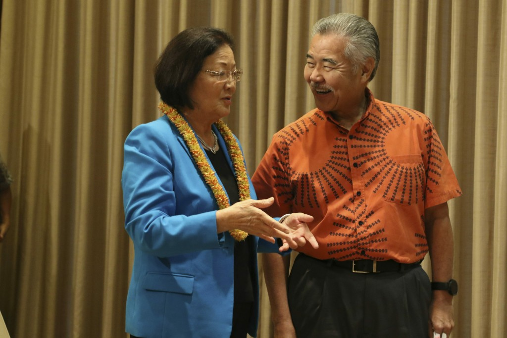 Hawaii Gov. David Ige, right, and U.S. Sen. Mazie Hirono chat before Ige signs bills in Honolulu on Tuesday, July 2, 2019. Ige signed legislation maki...